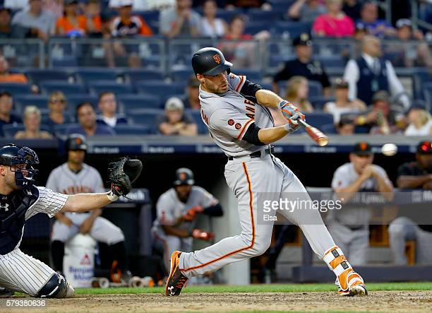 Mac Williamson of the San Francisco Giants hits an RBI single in the 12th inning as Brian McCann of the New York Yankees defends on July 23 2016 at...