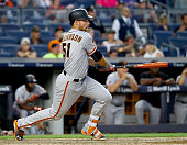 Mac Williamson of the San Francisco Giants hits an RBI single in the 12th inning against the New York Yankees on July 23 2016 at Yankee Stadium in...