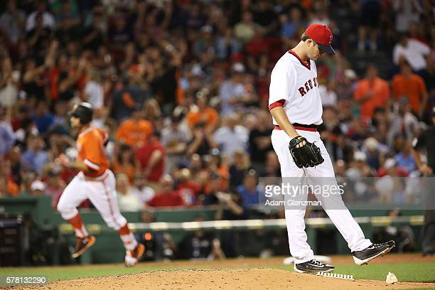 Mac Williamson of the San Francisco Giants rounds the bases after hitting a threerun home run as Drew Pomeranz of the Boston Red Sox looks on in the...