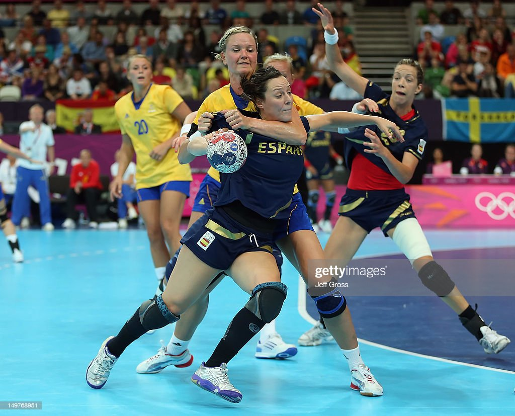 Macarena Aguilar Diaz #10 of Spain is tied up by <a gi-track='captionPersonalityLinkClicked' href=/galleries/search?phrase=Johanna+Wiberg&family=editorial&specificpeople=2156103 ng-click='$event.stopPropagation()'>Johanna Wiberg</a> #18 of Sweden during the Women's Handball Preliminaries Group A match between Spain and Sweden on Day 7 of the London 2012 Olympic Games at Copper Box on August 3, 2012 in London, England.