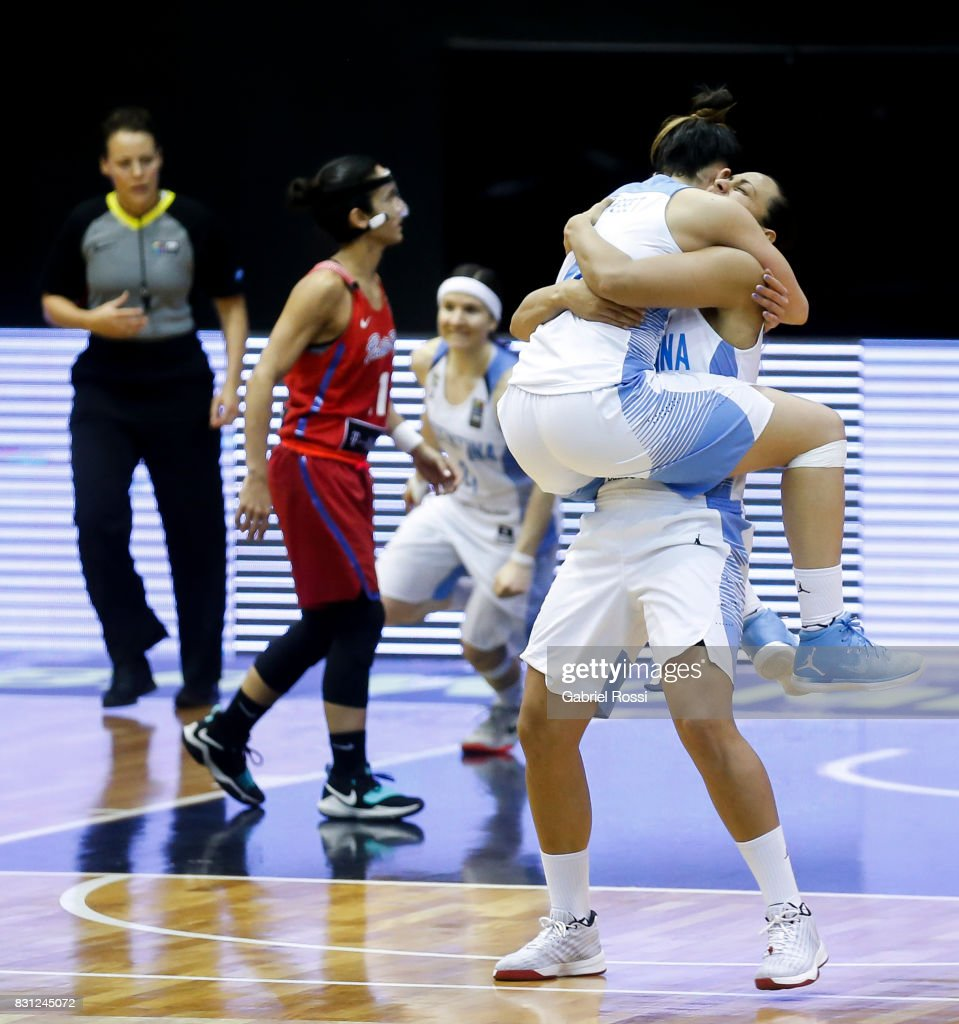Macarena Rosset of Argentina celebrates with a teammate after winning the match between Argentina and Puerto Rico as part of the FIBA Women's AmeriCup Semi Final at Obras Sanitarias Stadium on August 12, 2017 in Buenos Aires, Argentina.