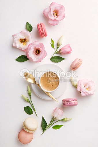 Macarons And Flowers On A White Background Colorful French Dessert