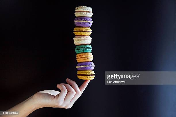 Macaroons balanced on finger