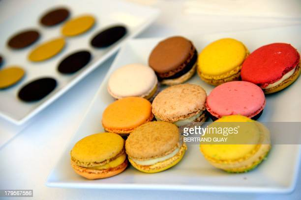Macaroons made by French pastry chef Pierre Herme are displayed in a showroom during a presentation to the press on September 5 2013 in Paris GUAY
