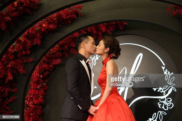 Macau businessman Levo Chan and his wife actress Ady An arrive at the red carpet of their own banquet on June 23 2017 in Taipei Taiwan of China Macau...