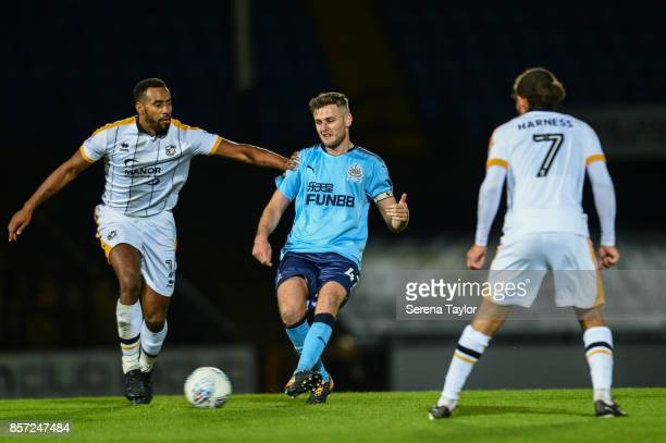 Macauley Gillesphey of Newcastle United runs with the ball during the EFL Checkatrade Trophy match between Port Vale and Newcastle United at Vale...