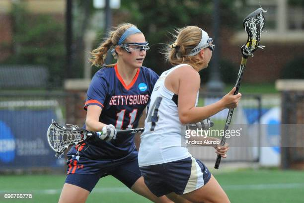 Macauley Mikes of Gettysburg College defends Elizabeth Morrison of the College of New Jersey during the Division III Women's Lacrosse Championship...