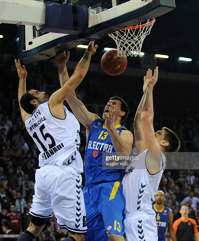 Maccabi Electra Tel Aviv's Darko Planinic (C) fights for the ball with Besiktas' Serhat Cetin (L) and Gasper Vidmar (R) on January 31, 2013 during a Euroleague basketball match at the Abdi Ipekci Sports Hall in Istanbul. KILIC