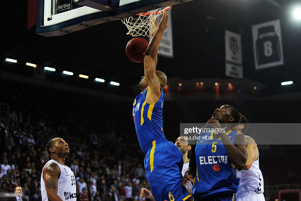Maccabi Electra Tel Aviv`s Devin Smith (C) scores during the Euroleague basketball match between Maccabi Electra Tel Aviv and Besiktas at the Abdi Ipekci Sports Hall in Istanbul on January 31, 2013.