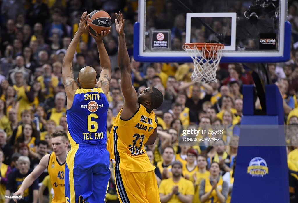 Maccabi Electra Tel Aviv's US guard <a gi-track='captionPersonalityLinkClicked' href=/galleries/search?phrase=Devin+Smith+-+Basketball+Player&family=editorial&specificpeople=13926073 ng-click='$event.stopPropagation()'>Devin Smith</a> (L) and Alba Berlin's US forward Jamel McLean vie for the ball during the Euroleague basketball match Alba Berlin vs Maccabi Electra Tel Aviv at the O2 Arena in Berlin on April 9, 2015.