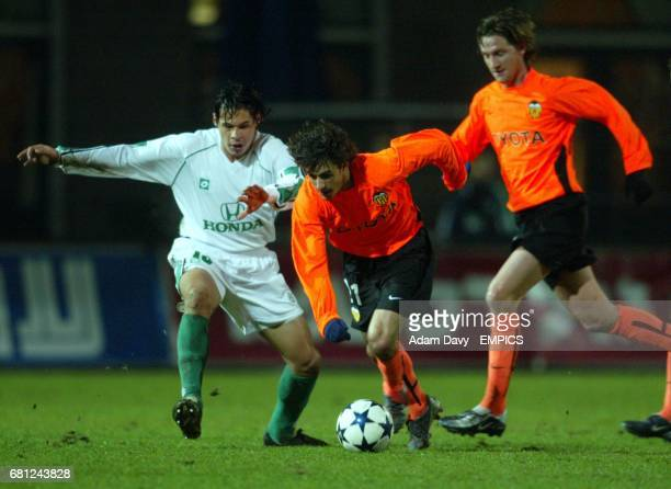 Maccabi Haifa's Jorge Britez and Valencia's Pablo Aimar battle for the ball