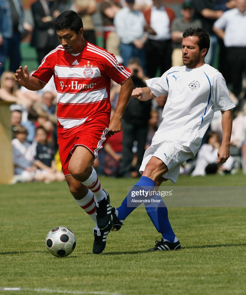 Maccabi Muenchen player Lothar Matthaeus tackles Bayern Muenchen All Star player Giovane Elber during a friendly soccer match between Maccabi...