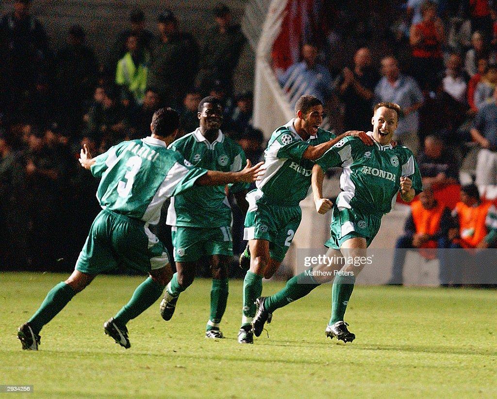 Maccabi players celebrate Raimandas Zutautta's goal during the UEFA Champions League match between Maccabi Haifa v Manchester United at the GSP...