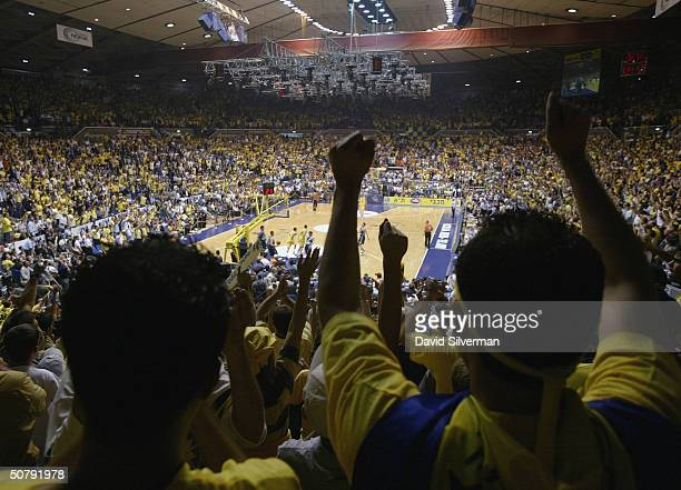 Maccabi Tel Aviv fans celebrate their team's 11874 win over Skipper Bologna in the finals May 1 2004 of the 2004 Euroleague Final Four tournament in...