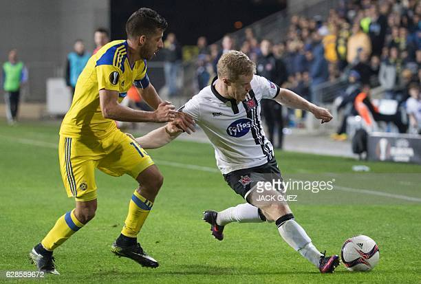 Maccabi Tel Aviv's Israeli midfielder Dor Miha tries to tackle Irish midfielder Daryl Horgan during the UEFA Europa League group D football match...