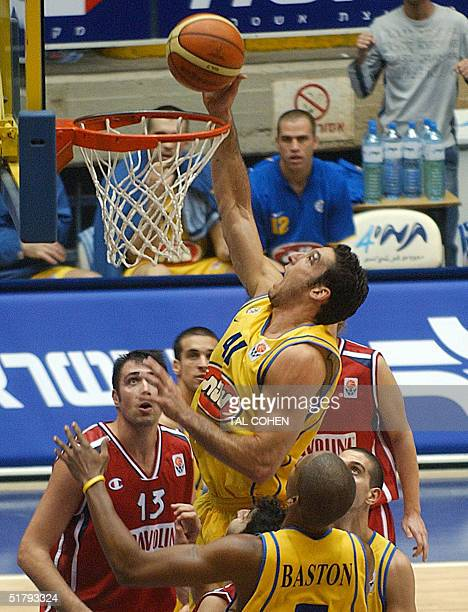 Maccabi Tel Aviv's Yariv Green dunks during the Euroleague match against Italian team Scavolini Pesaro at the Yad Eliyahu stadium in Tel Aviv 25...