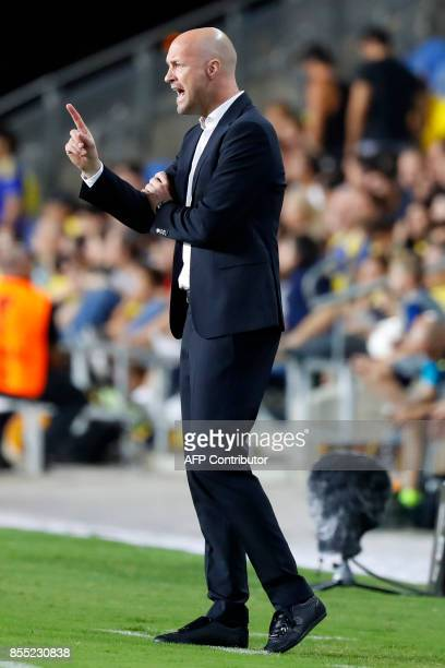 Maccabi's Dutch manager Jordi Cruyff gestures during the UEFA Europa League Group A football match between Maccabi Tel Aviv and Villarreal at the...