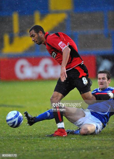 Macclesfield Town's Lee Bell slides in on Bournemouth's Ross Draper during the CocaCola Football League Two match at Moss Rose Macclesfield