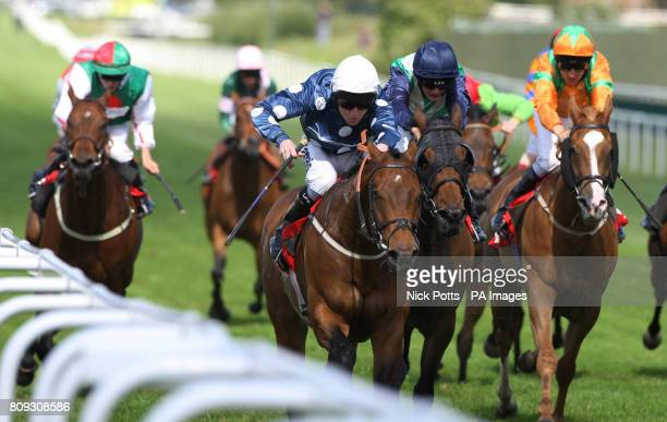 Macdillion ridden by Liam Keniry wins The BET totepool AT totesportcom Handicap Stakes during the totepool Irish Day at Sandown Park Racecourse Surrey