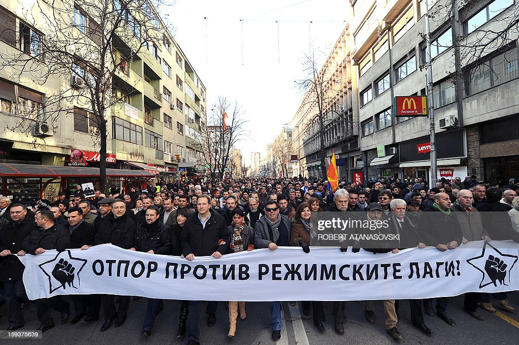Macedonian opposition supporters carry on January 12, 2013 a banner, reading: 'Resistance Against the Lies of the Regime,' during a protest called the 'Truth March' in Skopje. Macedonia on January 11 called local elections for March 24 in a tense political climate that has reigned since opposition boycotted parliament last month. Macedonia has been in a deep political crisis since December 24, when 17 people, including 11 policemen and two deputies, were slightly injured in scuffles over the 2013 budget. AFP PHOTO / ROBERT ATANASOVSKI