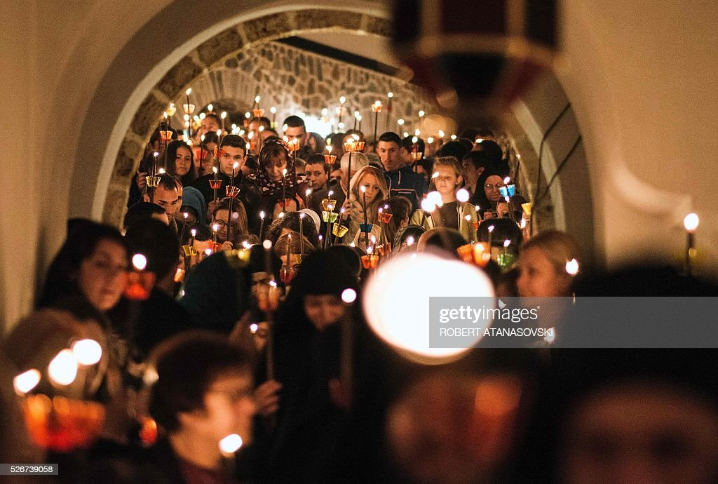 Macedonian Orthodox Christians hold candles as they take in midnight Easter services at the St. Jovan Bigorski monastery some 145 km west from the capital Skopje, on May 1, 2016. The Macedonian Orthodox Church celebrate Easter according to the Julian calendar. / AFP / Robert ATANASOVSKI