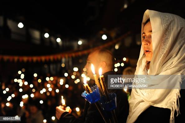 Macedonian Orthodox Christians hold candles as they take part in a midnight Easter service at the Saint Jovan Bigorski monastery in Mavrovo some 115...