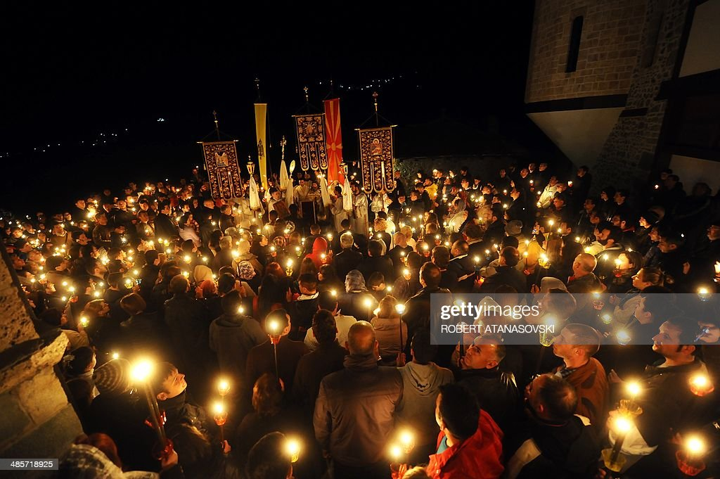 Macedonian Orthodox Christians hold candles as they take part in an Easter service at the Saint Jovan Bigorski monastery, in Mavrovo, some 145 km west from the capital Skopje, in Macedonia, on April 20, 2014.The Macedonian Orthodox Church celebrated Easter, according to the Julian calendar.