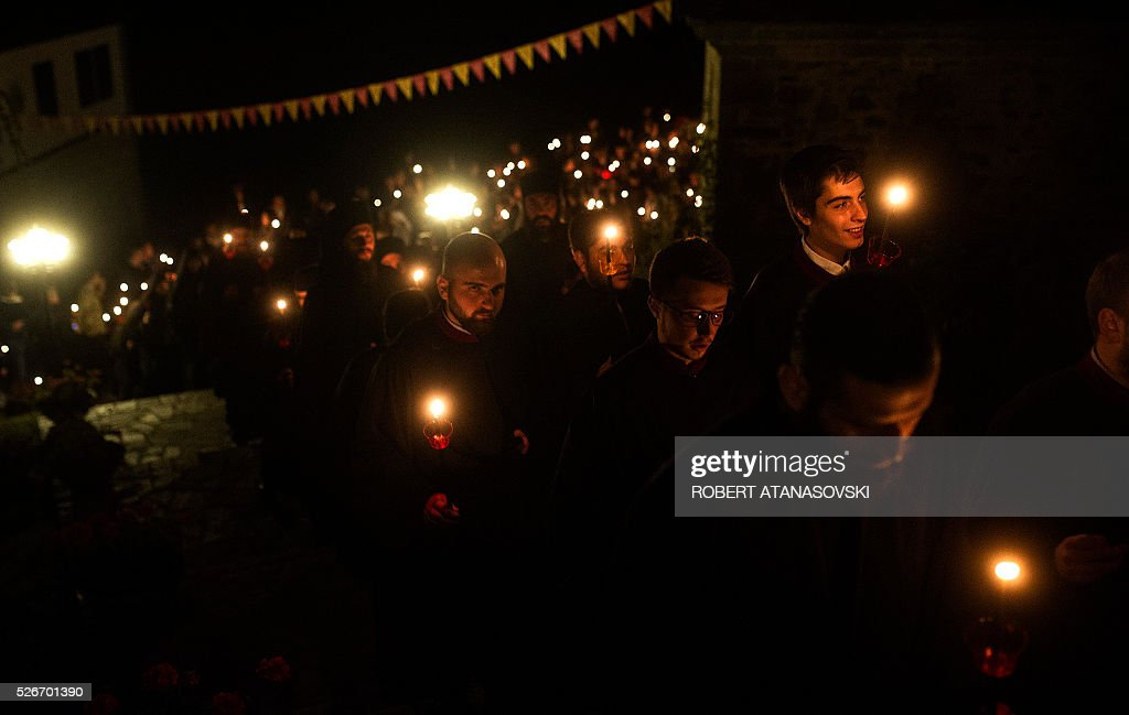Macedonian Orthodox Christians hold candles as they take part in midnight Easter services at the Saint Jovan Bigorski monastery, in Mavrovo, some 145 km west from the capital Skopje, in Macedonia,on May 1, 2016. The Macedonian Orthodox Church celebrates Easter according to the Julian calendar. / AFP / Robert ATANASOVSKI