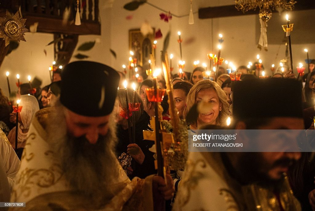 Macedonian Orthodox Christians hold candles as they take part in midnight Easter services at the Saint Jovan Bigorski monastery, in Mavrovo, some 145 km west from the capital Skopje, in Macedonia,on May 1, 2016. The Macedonian Orthodox Church celebrated Easter, according to the Julian calendar. / AFP / Robert ATANASOVSKI