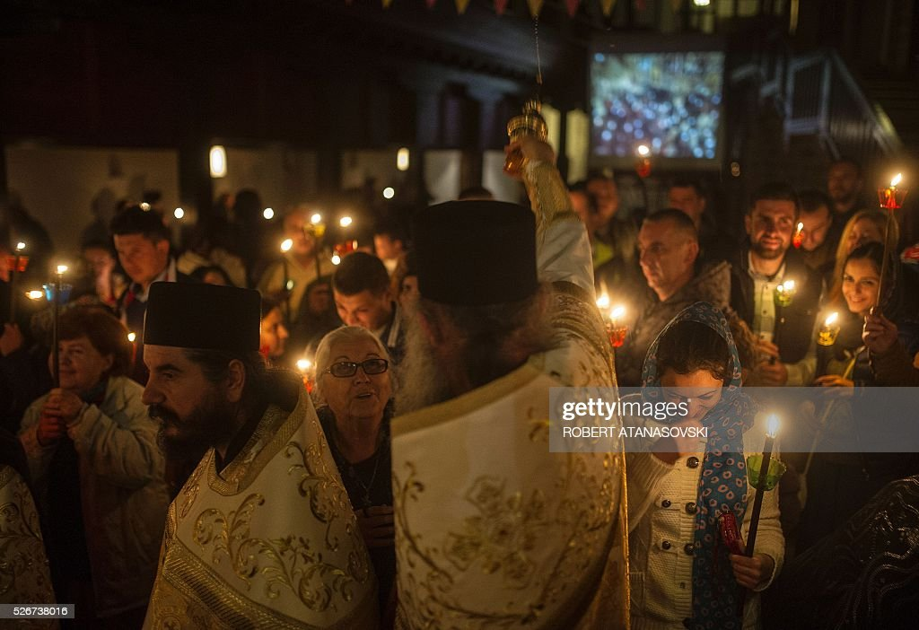 Macedonian Orthodox Christians hold candles as they take part in midnight Easter services at the Saint Jovan Bigorski monastery, in Mavrovo, some 145 km west from the capital Skopje, in Macedonia,on May 1, 2016. The Macedonian Orthodox Church celebrate Easter according to the Julian calendar. / AFP / Robert ATANASOVSKI