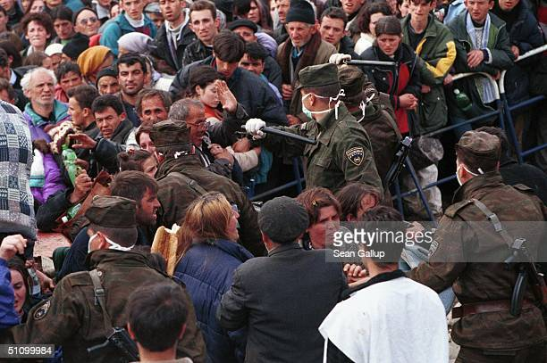 Macedonian Police Beat Back Albanian Refugees Seeking To Get To Waiting Buses At Blace Macedonia April 6 At The Border With Kosovo Where An Estimated...