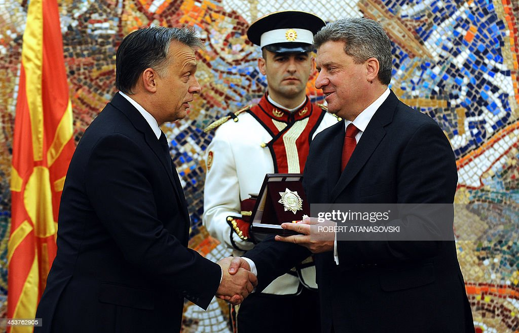 Macedonian President <a gi-track='captionPersonalityLinkClicked' href=/galleries/search?phrase=Gjorge+Ivanov+-+Politician&family=editorial&specificpeople=12777955 ng-click='$event.stopPropagation()'>Gjorge Ivanov</a> (R) awards Hungarian Prime Minister Viktor Orban (L) the 'September 8' order of outstanding merit in the development and strengthening of friendly relations and bilateral cooperation between the two countries during a ceremony at the presidential office in Skopje on December 5, 2013. Orban is on an official one-day visit to Macedonia.