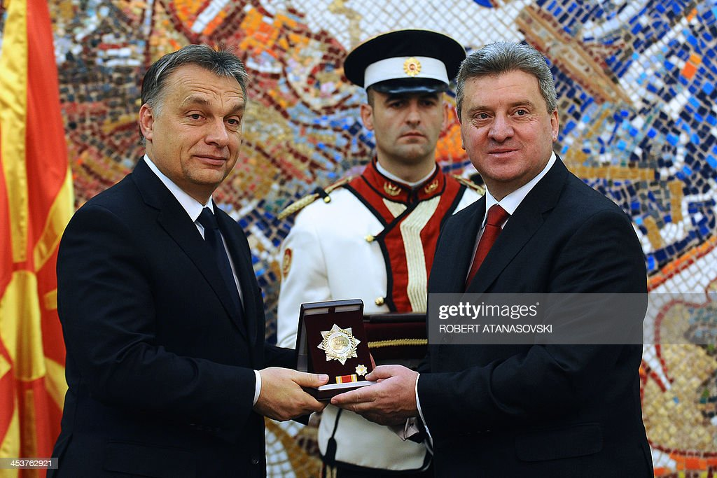 Macedonian President <a gi-track='captionPersonalityLinkClicked' href=/galleries/search?phrase=Gjorge+Ivanov+-+President&family=editorial&specificpeople=12777955 ng-click='$event.stopPropagation()'>Gjorge Ivanov</a> (R) awards Hungarian Prime Minister Viktor Orban (L) the 'September 8' order of outstanding merit in the development and strengthening of friendly relations and bilateral cooperation between the two countries during a ceremony at the presidential office in Skopje on December 5, 2013. Orban is on an official one-day visit to Macedonia.