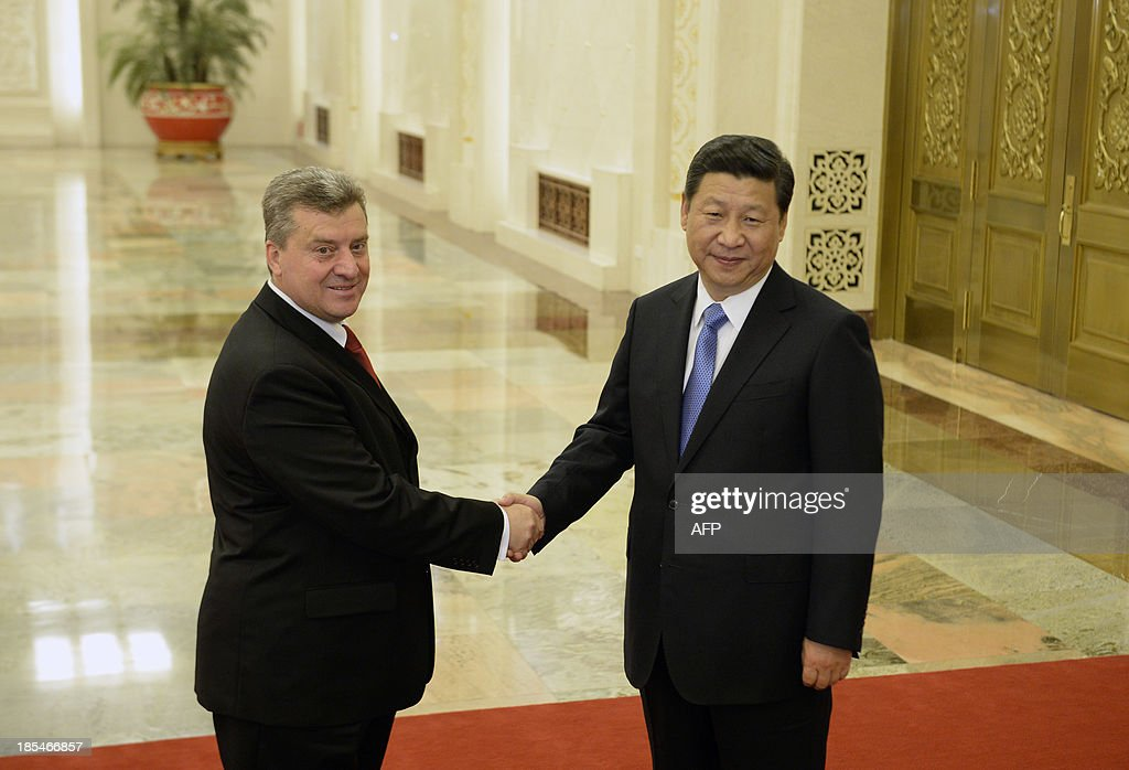 Macedonian President Gjorge Ivanov (L) shakes hands with Chinese President Xi Jinping (R) before a meeting at the Great Hall of the People in Beijing on October 21, 2013.