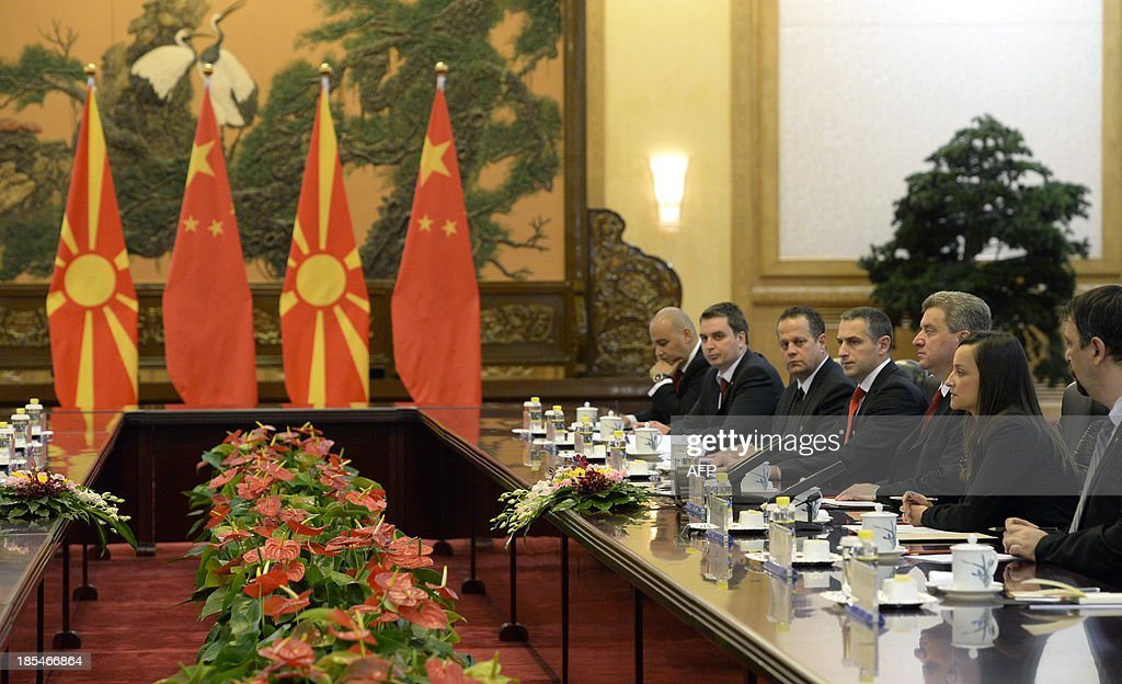 Macedonian President Gjorge Ivanov(3rd R) talks to Chinese President Xi Jinping (unpictured) during a meeting at the Great Hall of the People in Beijing on October 21, 2013.