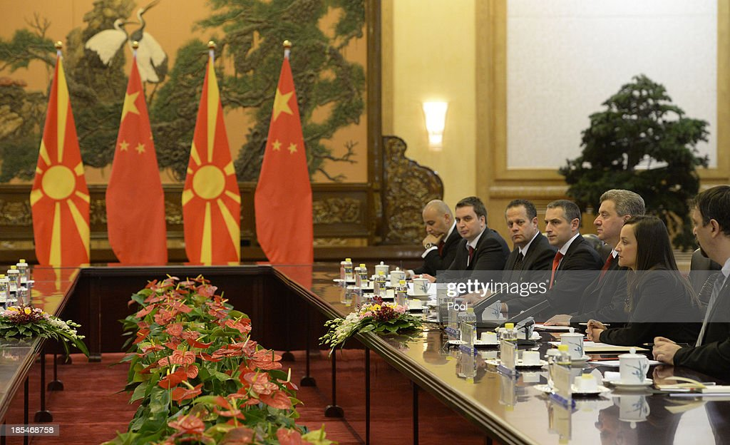 Macedonian President Gjorge Ivanov (3rd R) talks to Chinese President Xi Jinping during a meeting at the Great Hall of the People on October 21, 2013 in Beijing, China.