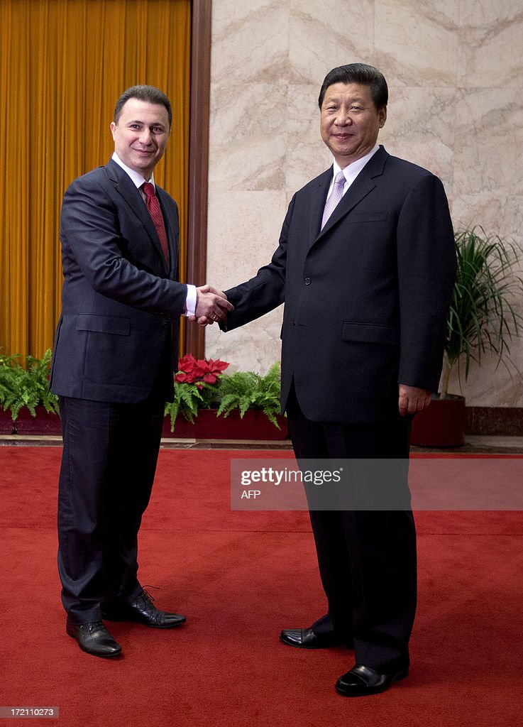 Macedonian Prime Minister Nikola Gruevski (L) is greeted by Chinese President Xi Jinping upon arrival for a meeting at the Great Hall of the People in Beijing on July 2, 2013. Gruevski will also meet representatives of Chinese companies while on his official visit as he seeks to attract Chinese investments in Macedonia. AFP PHOTO / Andy Wong / POOL