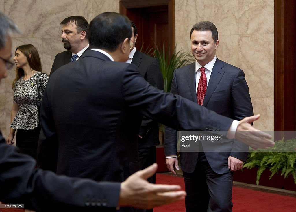 Macedonian Prime Minister <a gi-track='captionPersonalityLinkClicked' href=/galleries/search?phrase=Nikola+Gruevski&family=editorial&specificpeople=567539 ng-click='$event.stopPropagation()'>Nikola Gruevski</a> (R) is shown the way by his Chinese counterpart <a gi-track='captionPersonalityLinkClicked' href=/galleries/search?phrase=Li+Keqiang&family=editorial&specificpeople=2481781 ng-click='$event.stopPropagation()'>Li Keqiang</a> as they head to a meeting at the Great Hall of the People July 2, 2013 in Beijing, China. Leaders from China and Eastern Europe met to discuss economic relations and bilateral cooperation between their countries.