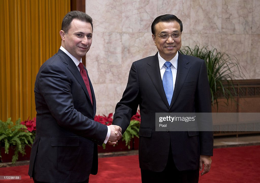 Macedonian Prime Minister Nikola Gruevski (L) shakes hands with his Chinese counterpart Li Keqiang as they pose for photographers before their meeting at the Great Hall of the People July 2, 2013 in Beijing, China. Leaders from China and Eastern Europe met to discuss economic relations and bilateral cooperation between their countries.