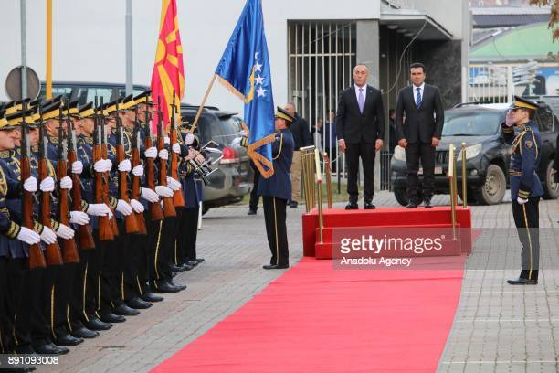 Macedonian Prime Minister Zoran Zaev stands next to Kosovan Prime Minister Ramush Haradinaj during the welcoming ceremony ahead of their meeting in...
