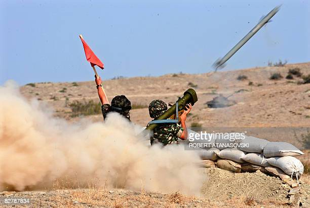 Macedonian soldier fire an antiaircraft missile with the Russianmade Igla groundtoair launcher supervised by a Slovenian military instructor during a...