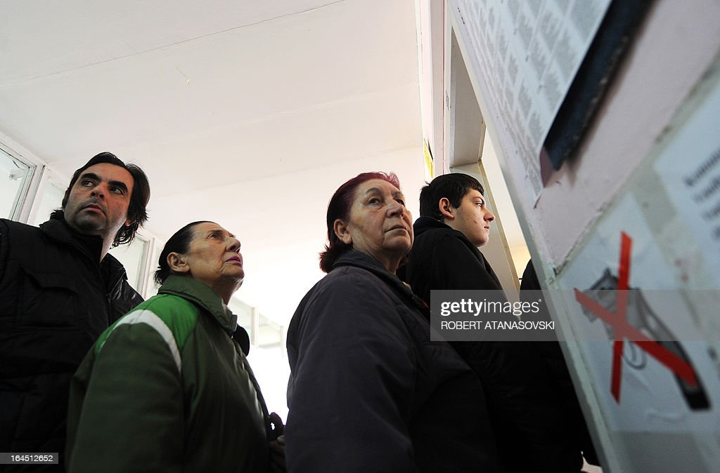 Macedonian voters wait to cast their ballos at a polling station in Skopje on March 24, 2013, as part of the local elections held against a backdrop of ethnic tensions, as a political crisis between the right-wing government majority and left-wing opposition rumbles on.