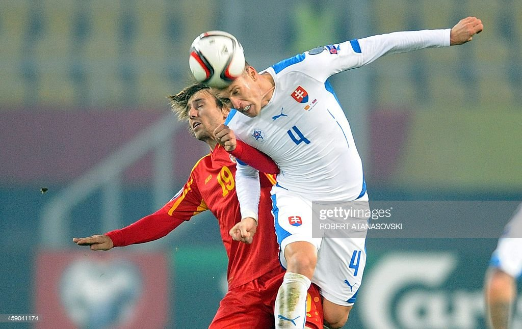 Macedonia's Besart Abdurahimi vies with Slovakia's Jan Durica during the UEFA Euro 2016 qualifying football match between Macedonia and Slovakia at...