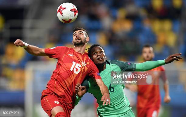 Macedonia's defender Egzon Bejtulai and Portugal's midfielder Renato Sanches vie for the ball during the UEFA U21 European Championship Group B...
