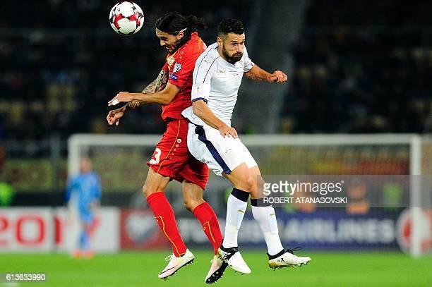 Macedonia's defender Leonard Zhuta vies with Italy's midfielder Antonio Candreva during the FIFA World Cup 2018 qualifying football match between...