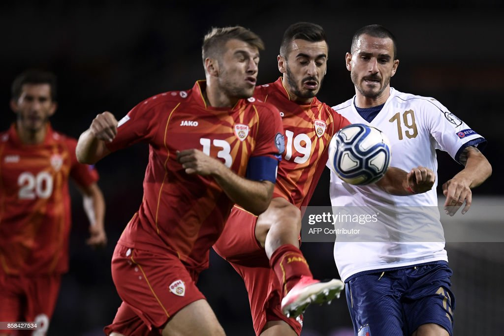 Macedonia's defender Stefan Ristovski (L), Macedonia's forward Marjan Radeski (C) and Italy's defender Leonardo Bonucci (R) fight for the ball during the FIFA World Cup 2018 qualification football match between Italy and Macedonia on October 6, 2017 at the Grande Torino Stadium in Turin. /