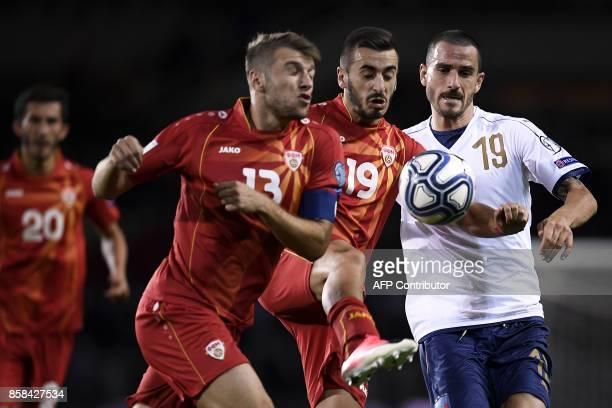 Macedonia's defender Stefan Ristovski Macedonia's forward Marjan Radeski and Italy's defender Leonardo Bonucci fight for the ball during the FIFA...