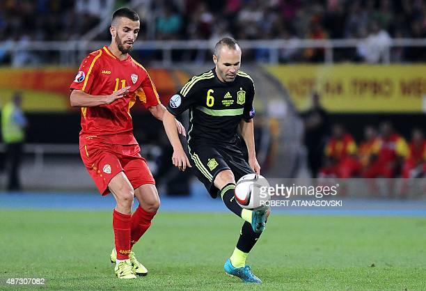 FYR Macedonia's Feran Hasani vies with Spain's Andres Iniesta during the Euro 2016 Group D qualifying football match between FYR Macedonia and Spain...