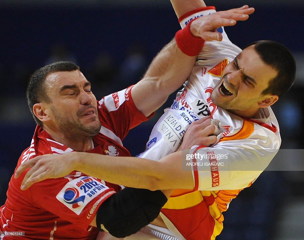Macedonia's Filip Lazarov (R) vies with Poland's Bartosz Jurecki (L) during the men's EHF Euro 2012 Handball Championship match Poland vs Macedonia on January 23, 2012 at the Belgrade Arena.