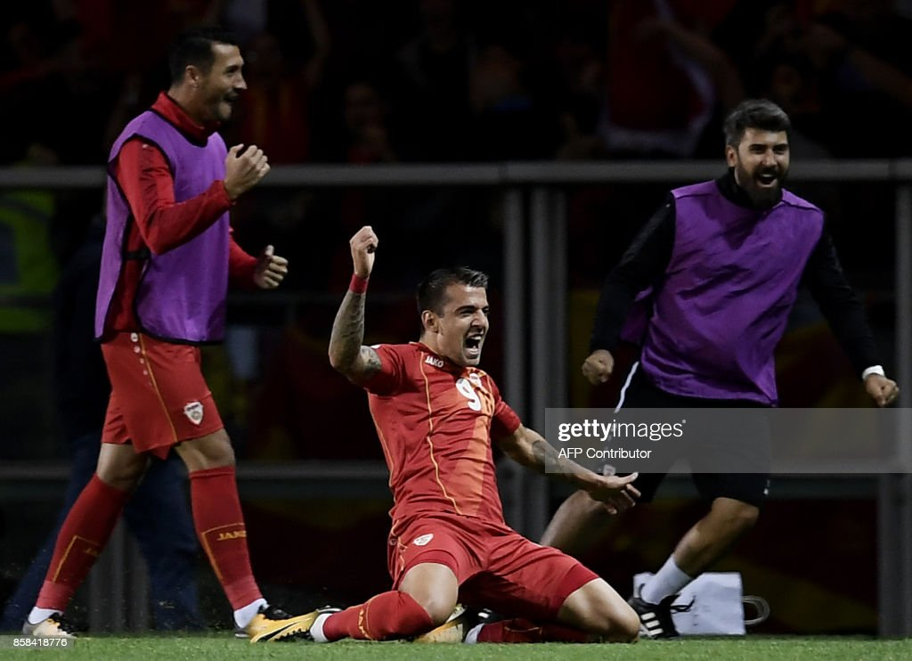 Macedonia's forward Aleksandar Trajkovski (C) celebrates scoring his team's first goal during the FIFA World Cup 2018 qualification football match between Italy and Macedonia at The 'Grande Torino Stadium' in Turin on October 6, 2017. /